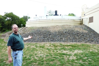 Chris Manak showing one of the digesters