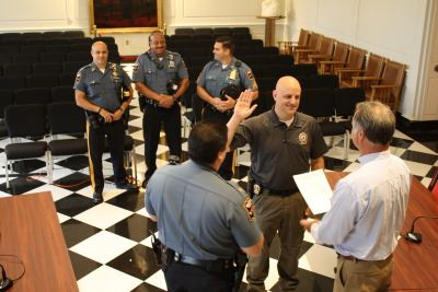 Officer in a Blue Polo Being Sworn in