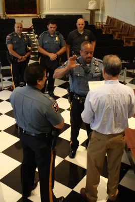 Officer in a Police Uniform Being Sworn in